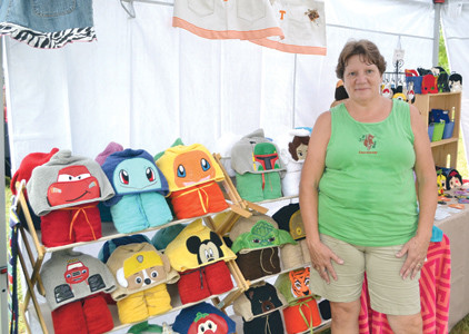 THERE WERE several booths with vendors selling a variety of items at the Calhoun River Town Festival, including Barbara Knicely of Bearawear, who was featuring her bath towels with faces she embroidered on them.