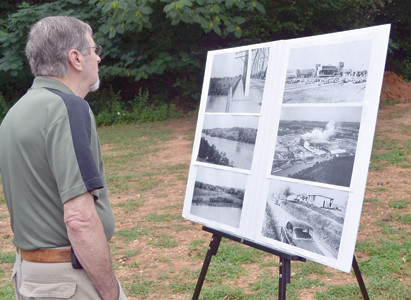 JIMMY LINER, formerly of Calhoun now living in Cleveland, enjoyed looking at some of the old historical photographs on display at the River Town Festival Saturday morning.