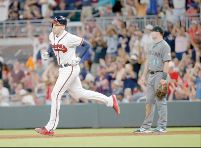 Atlanta Braves' Freddie Freeman (5) runs past Arizona Diamondbacks first baseman Paul Goldschmidt (44) as he rounds the bases after hitting a home run in the sixth inning of a baseball game Friday, July 14, 2017, in Atlanta. (AP Photo/John Bazemore)