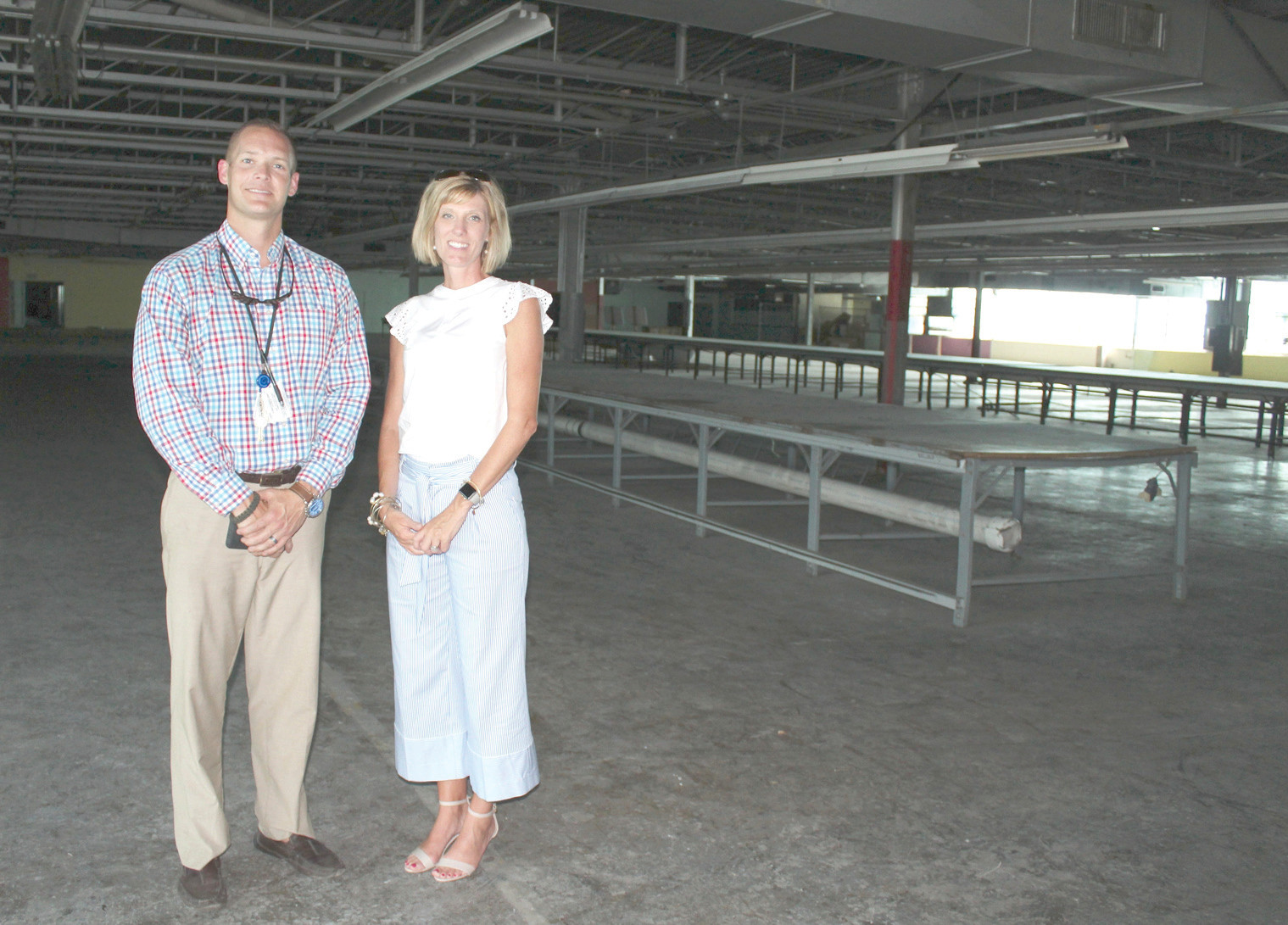 THE POSSIBILITIES of the old American Uniform manufacturing facility have Kyle Page, principal of GOAL Academy and the facility's project manager, and Brittany Cannon, work-based learning coordinator for Bradley County Schools, seeing its expansive rooms as more than just empty space.