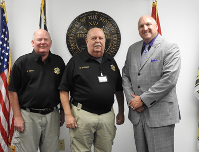 SENIOR LT. Mike Boggess has been promoted to captain over the Support Services Division at the Bradley County Sheriff's Office. From left are Chief Deputy Brian Smith, Boggess and Sheriff Eric Watson.