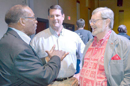 AVERY JOHNSON, left, and Leroy Rymer Jr., right, both representing Magic Chef, speak with Matthew Brown, center, of Brown Stove Works before Thursday night's stove history roundtable at the Museum Center at Five Points.