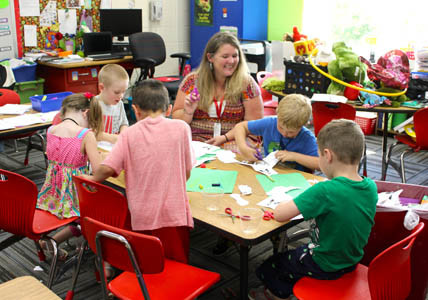 TEACHER Melanie James leads students in an activity during Valley View Elementary School's Kindergarten Camp, which was for students starting kindergarten this fall.