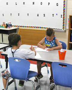 YOUNG STUDENTS practice using pencils to write their names during Valley View Elementary School's Kindergarten Camp.