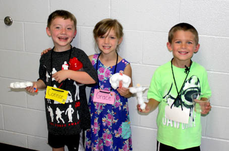 FUTURE KINDERGARTENERS, from left, Connor Keith, Grace Stiles and Easton Ingram, show off crafts made during Valley View Elementary School's Kindergarten Camp.