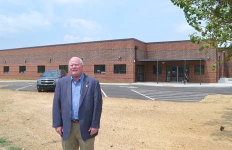 THE BRIAN K. SMITH Workhouse will begin accepting non-violent offenders now that it has been officially opened at the Bradley County Justice Center. The workhouse is named after Bradley County Sheriff's Office Chief Deputy Brian Smith, seen here in both photographs, a longtime veteran of local law enforcement.
