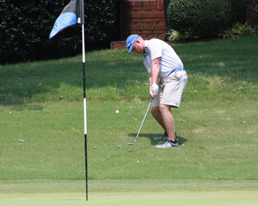 CLEVELAND SENIOR Drew Linkous chips off the hillside on the first green during a playoff in the Bradley Central Invitational one-day shotgun style tournament. Linkous shot a 71 through 18 holes and then parred and birdied to win the 2-hole playoff.