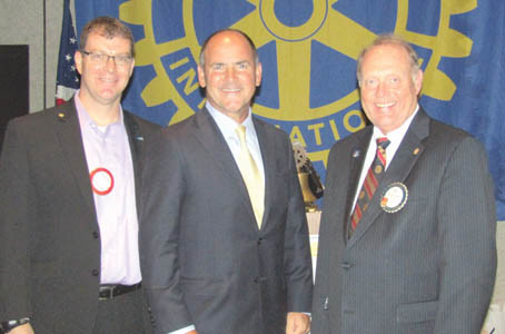 Former U.S. Rep Zach Wamp, center, is greeted by Rotary Club of Cleveland program chairman Dr. Matt Ryerson, left, and Club President Bill Brown, right.