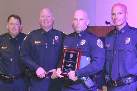 THE OFFICER OF THE YEAR award was presented to Officer Josh Hodge at the awards luncheon. From left are Chief Mark Gibson, Capt. Stacy Smith, Hodge, and Capt. Robert Harbison.