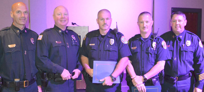 LIFE SAVING awards were presented to three officers for competent and expedient action which was directly responsible for sustaining or saving a human life, or for an act which removed a person from immediate danger when such danger would or coult have take the person's life.