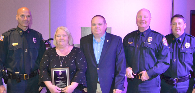 GAIL TILLEY and Travis Weber were both recognized with special awards by the Cleveland Police Department.  Tilley received the Civilian of the Year award, while Weber was named Distinguished Peer of the year.  From left are Capt. Robert Harbison, Tilley, Weber, Capt. Stacy Smith, and Chief Mark Gibson.