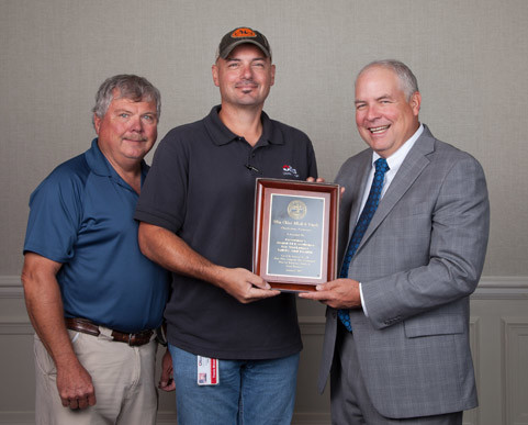 THE OLIN CHLOR Alkali and Vinyls plant in Charleston was recently awarded the Governor's Award of Excellents for Workplace Safety and Health. Standing, from left, are Ernie Taylor, Olin responsible care technician; and Travis Moser, Olin responsible care technician; and Steve Hawkins, Tennessee Safety and Health Congress co-chair.