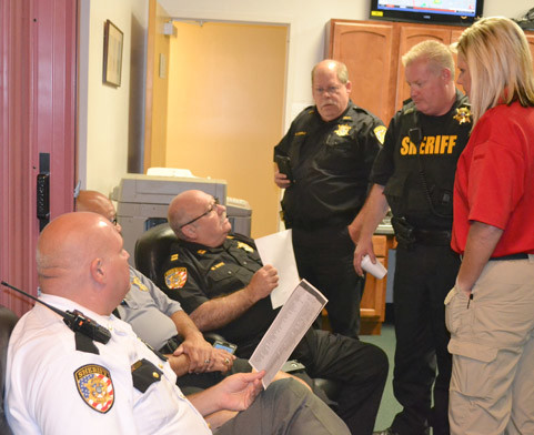 BRADLEY COUNTY SHERIFF'S OFFICE deputies discuss preparations for the Aug. 21 solar eclipse at a meeting this past week at the Emergency Operations Center. From left are Russ Henry, Mario Santos, Wayne White, Richard Cobble, Brian Quinn and Julie Quinn.