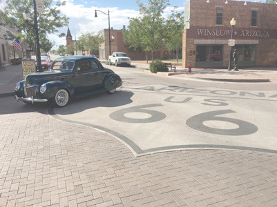 "LARRY TIMMERMAN'S 1939 Ford Coupe not only traveled Route 66, but stopped at the corner in  Winslow,  Ariz., made famous in The Eagles' song ""Take It Easy."""