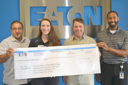 From left are plant manager Cesar Escarcega, Relay for Life's Chrissy Seals, Foley, and Michael Patterson, Eaton human resources.