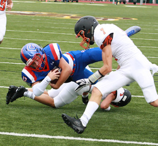 JUNIOR QUARTERBACK Kellye Cawood (12) dives head first across the goal line for six points in Cleveland's 23-0 victory over Lenoir City in a two-quarter jamboree at Rhea County High School Friday night. The newcomer for the Blue Raiders totaled 181 yards on just three drives and accounted for two touchdowns.