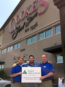 JUNIOR ACHIEVEMENT of the Ocoee Region is continuing its fundraising partnership with Cooke's Food Stores and Fresh n' Low. The drive continues through Aug. 22, and encourages grocery store customers to make donations to the local nonprofit. From left are Cooke's representatives Jake Vincent, assistant manager; Jordan Caughey, marketing specialist; and Keith Scott, store manager.