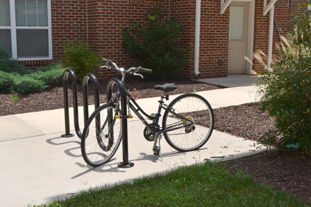 WITH MANY STUDENTS using bicycles to get around the area, each unit at The Flats has a bike rack.