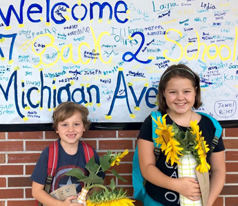 STUDENTS at Michigan Avenue Elementary were excited on the first day of school. Here, fourth-grader Miriam Hynes and her first-grade brother, Graham, pose for a photo.