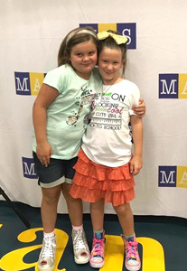 SECOND-GRADERS Sydney Lewallen and Annabelle Brnik strike a pose before beginning their first day at Michigan Avenue Elementary.
