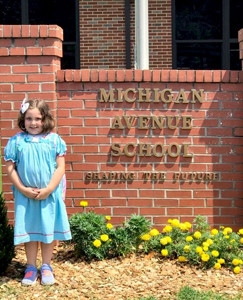 CASEY CLARK was all smiles after her first full day of kindergarten in Taylor Fugate's Class at Michigan Avenue Elementary School.