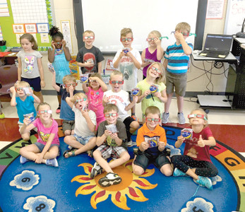 First-graders in Emily Ledford's class at Park View Elementary School are ready for Monday's solar eclipse. On Friday, they received pairs of solar eclipse viewing glasses to take home, along with a special snack of Moon Pies.