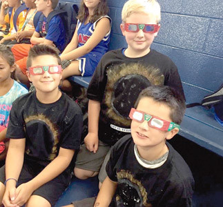 FOURTH-GRADERS Caden Williams, Johnathan West, and Jayden Granados learned how to safely use solar eclipse glasses during science class at North Lee Elementary School.