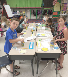 Lynnae Roberts' second-grade class, above and below, at Charleston Elementary have been studying the sun, moon, moon phases and all about the eclipse this week getting ready for Monday's big event.