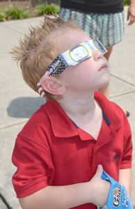LOGAN HARPER experienced the eclipse with his parents at Cleveland State Community College on Monday.