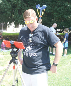 MATT FARRELL, a STEM teacher from Baker Elementary School in Acworth, Ga., visited Cleveland with his family and friends Monday, to watch the eclipse. He used the opportunity to measure the impact of the wind during the celestial event.