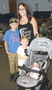 Lana Jones watched the celestial event with her son, Kyson, daughter, Kynlee, and 3-week-old daughter, Charley — probably the youngest viewer anywhere.