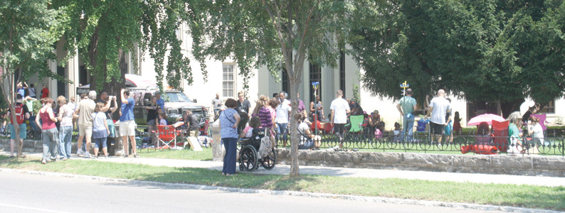 LOCAL RESIDENTS WERE joined by a number of people from out of town as they watched the solar eclipse in front of the Cleveland Bradley County Public Library on Monday afternoon. More than 500 viewers scattered around the library facilities for the historic event.