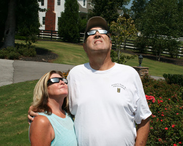 "PETER AND SUSAN GOODWIN wore special solar glasses to observe Monday's total eclipse, which they planned on watching from their front garden area. The owners of Foster's Trail and Alpaca Farm said they were curious to see how their animals would react to the sudden darkness and reappearance of the sun. ""I want to see if they'll go in at night like they normally do,"" Peter said. According to Susan, the alpacas were in the barn but as soon as it started to lighten up from the darkness, they all emerged from the barn. ""They thought it was morning,"" she said. ""It was too funny."""