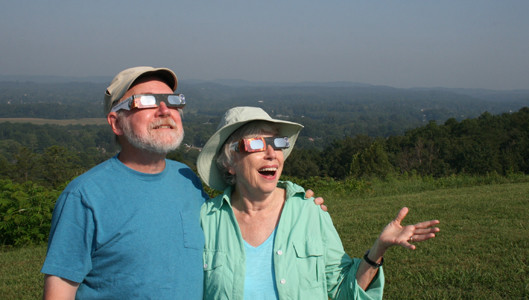 "ANNE AND JACK Coulehan drove from Long Island, N.Y. to Cleveland to experience one of nature's most awe-inspiring sights — a total solar eclipse. Anne, a retired chaplain, said, ""As I understand it, this is the first eclipse that has only been visible from the United States. It's the first total eclipse that is exclusive to the United States since the founding of our country, so it's a big deal."" Jack, an internal medicine physician who taught at Stony Brook University School of Medicine in New York, said, ""It's like a quest. You have to have imagination — things to do that's out of the ordinary and this seemed like the right thing to do."" Married 51 years, the adventurous couple is originally from Western Pennsylvania and were coincidentally escorted by a stranger to the Mountain View Inn, where tourists from across the country were arriving and had parked for a scenic view of the eclipse. Anne explained, ""The place where we used to have our fancy parties was the Mountain View Inn in Greensburg, Pa. It's very poetic to be here and in the path of totality! This is just amazing!"""