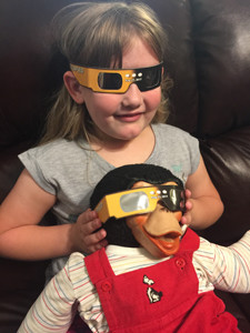 Debbie Moore shared this photo of her granddaughter Avery Coleman and Zippy the Chimp ready for the eclipse.