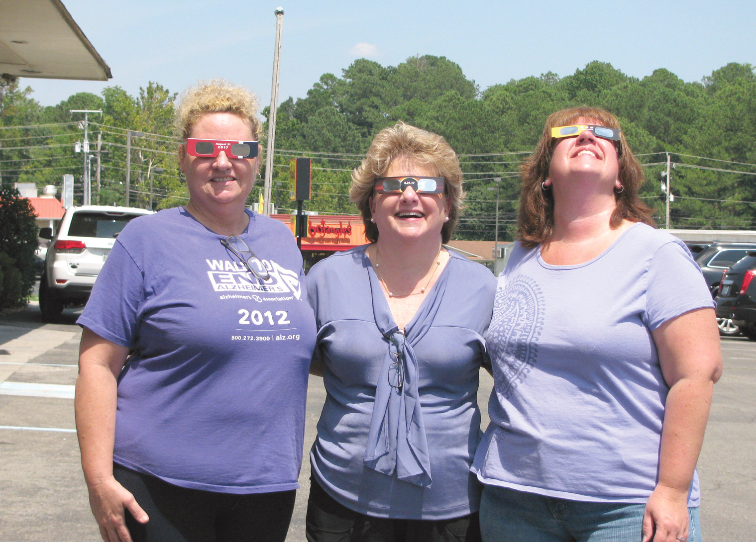 Donna Kaylor, Sheena Meyer and Trena Bailey take time out of work to watch the eclipse.