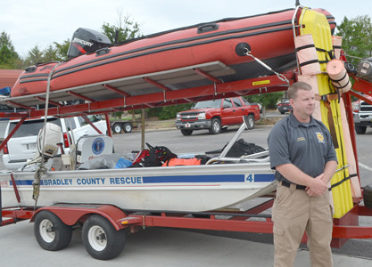TWO BOATS utilized by Bradley County Fire-Rescue will be transported, along with other materials, to Texas to help residents experiencing flooding in many areas. With the boats is Chief Shawn Fairbanks, who heads the BCFR, and selected the two firemen who will travel tin Texas.