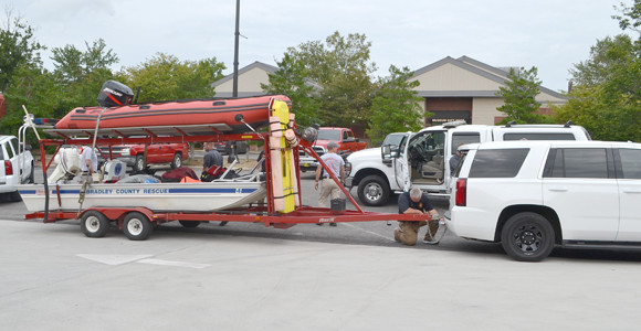 EAST RIDGE FIRE Chief Mike Williams hooks up the two boats from Bradley County Fire-Rescue that will be used in swiftwater rescues in Texas.