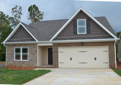 This new house in the Brook Hollow subdivision has three bedrooms, two baths, a two-vehicle garage and a bonus room upstairs.