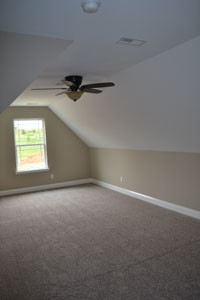 ON THE SECOND LEVEL is a nice bonus room, below, that can have a multitude of uses. Since it has a closet, it could be used as a fourth bedroom.