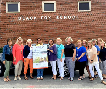 THE TEAM of volunteers who will be helping take people on test drives during the Buick Drive For Your Students event at Black Fox Elementary recently gathered for training at the school. The event, which has been postponed, is now set for Sept. 19.