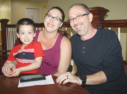 THE Booher FAMILY was at the center of weekend complaints of excessive hotel prices in the Cleveland area, especially with evacuees from Hurricane Irma and its remnants. Brian Booher and his wife, Tracy, along with their 4-year-old son Brody, are now happy with accommodations at the Douglas Inn and Suites.