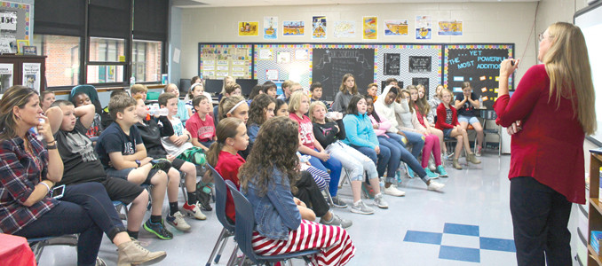 "CYNTHIA SHONTS, a Cleveland resident and the mother of a North Lee Elementary School student, spoke to her son's fifth-grade class earlier this week about the terrorist attacks in New York and Washington, D.C., on Sept. 11, 2001. Shonts was visiting Manhattan on business at the time of the tragedy, and was an eyewitness to the historic event that took the lives of almost 3,000 people overall. ""It's hard, but there's only so many generations that will get to hear firsthand accounts of 9/11,"" Shonts said of her decision to speak publicly of the event."