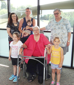 Suzanne Ables, center, progressing after a fall, surgery and then rehab at Life Care Centers of Cleveland. With her are her husband, John; grandson, Jeffrey Diak, and his wife and children.