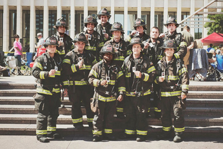 TWELVE CLEVELAND FIREMEN climbed 110 stairs to honor their fallen firefighters who died in the Sept. 11, 2001, 1terrorist attack in New York City. From left, back row, are Tim Hogg, Trent Nunnelly, Richard Lesniewski, Josh Mowery, Ryan Creech, Cody Vaughn and Robert Cannatella; front, Dallas Case, Luke Landers, Ben Achata, Tanner Goins and Nate Kuzdzal.