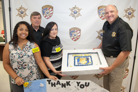 One of those first response organizations was the Bradley County Sheriff's Office. From left are Maranda Migneron of Cash Express, BCSO Director Arnold Botts, Briana Pankey of Cash Express, and Sheriff Eric Watson.
