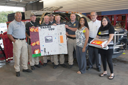 BRADLEY COUNTY FIRE-RESCUE was among the local first responders presented cakes in appreciation to their service by Cash Express. From left are Johnny Stokes, Justin Frey, Troy Maney, Daniel James, Shawn Fairbanks, Marcus Burger, Cash Express' Maranda Migneron, Bradley County Mayor D. Gary Davis, and Briana Pankey of Cash Express.