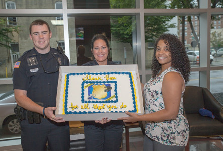 THE CLEVELAND POLICE DEPARTMENT was thanked by Cash Express last week, as one of the first response agencies in the community. From left are Officer Jordan Rymer, Sgt. Evie West, and Maranda Migneron of Cash Express.