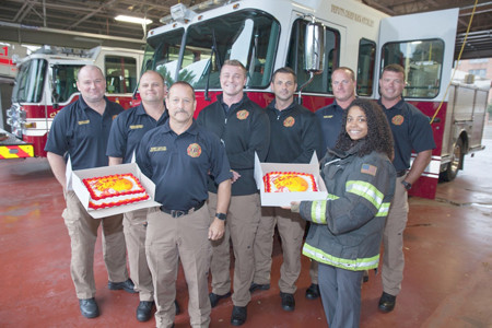 CASH EXPRESS thanked local first responders with cakes of appreciation last week, including the Cleveland Fire Department. From left are Micah AKins, Chris Pennell, Bobby Gaylor, Zach Jaggers, T.J. Smith, Michael McCabe, Maranda Migneron of Cash Express, and Jake Hill.