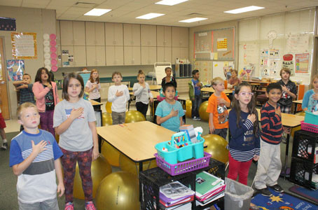 STUDENTS IN MRS. NORMAN'S class stand to sing the National Anthem for Star Spangled Banner Day.